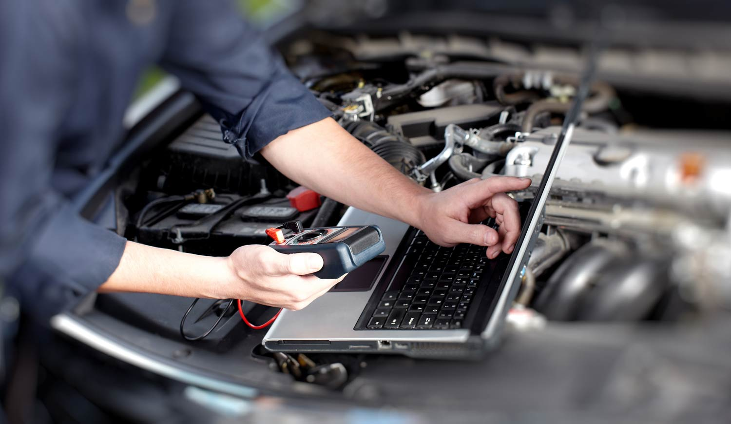 a mechanic diagnoses a hybrid battery and makes a hybrid battery repair